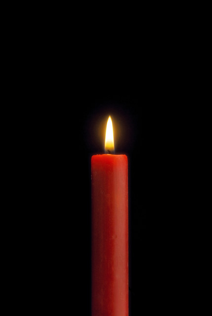 Red candle that is lit on black background | Flickr ...