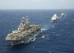 In this file photo, the Peleliu Amphibious Ready Group, consisting of USS Peleliu (LHA 5), USS Green Bay (LPD 20) and USS Rushmore (LSD 47), transit the Pacific Ocean in April. (U.S. Navy Photo by Mass Communication Specialist 3rd Class Michael Duran)