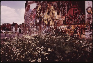 Deteriorated Wall Mural Adjacent To A Vacant Lot On 35th Street In South Side Chicago. Many Black Artists Are Active In Painting Outdoor Murals In The City's Black Communities, 07/1973