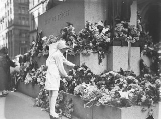 A Junior Red Cross girl lays a wreath on the Cenotaph, 25 Apr 1930, by Sam Hood