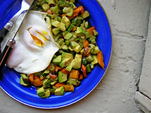 fried eggs with avocado zucchini hash