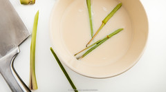 Chopped lemongrass, milk and chopping knife.