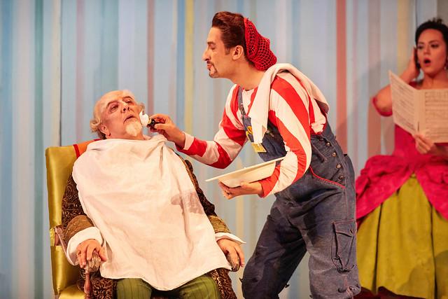 José Fardilha as Don Bartolo and Vito Priante as Figaro in Il barbiere di Siviglia, The Royal Opera © 2016 ROH. Photograph by Mark Douet