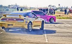 dirt track racing(0.0), race car(1.0), auto racing(1.0), automobile(1.0), racing(1.0), sport venue(1.0), vehicle(1.0), stock car racing(1.0), sports(1.0), performance car(1.0), race(1.0), automotive design(1.0), drifting(1.0), motorsport(1.0), rallycross(1.0), autocross(1.0), race track(1.0), sports car(1.0),