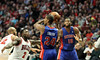 Chicago Bull Nate Robinson guards Detroit Piston Kim English while Greg Monroe calls for the pass
