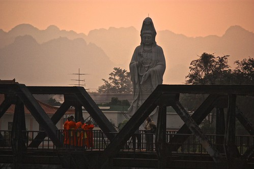monks hanging out on the bridge over River Kwai