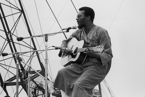 Folk artist Richie Havens opening the Woodstock Music Festival in Bethel, New York on August 15, 1969. Havens died on April 22, 2013.