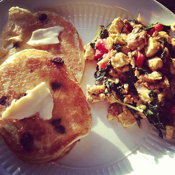 Dinner: #glutenfree #vegan chocolate chip pancakes and kale and tomato tofu scramble