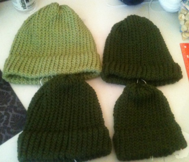 four more hats, three dark green one light green