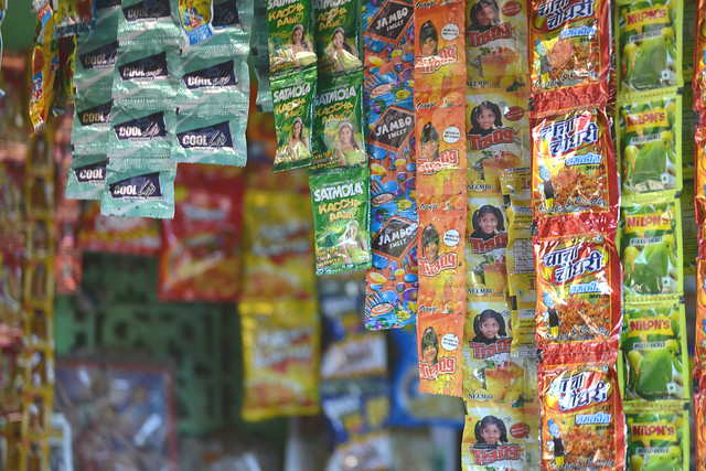 A picture of Sweets on a stall in India