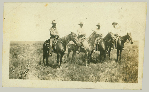 Four men on horseback