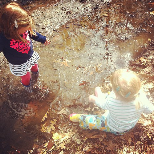 "today was a good day. muddy buddies at the ""fishin' puddle"" spring is finally here!"