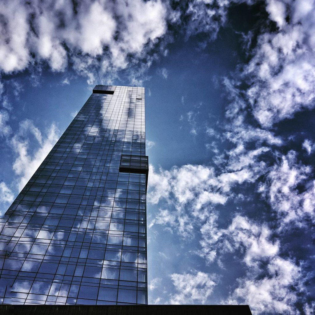 Up to the sky  #NewYork #nyc #lookingup #architecture #archilovers #modern #Glass #building #buildings #sky #cloudporn #bluesky #reflection #blue #colorful #Photo #Photography #Travel #trip #iloveny #ilovenyc #newyorkphoto #instacool #instanewyork #mynyc