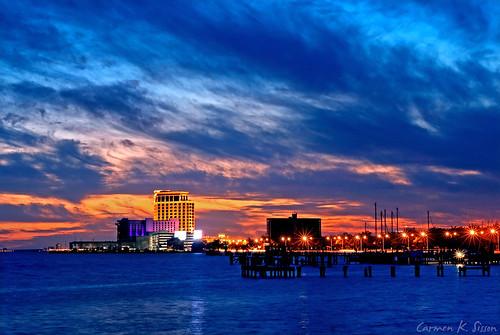 city sunset vacation usa gambling tourism beach gulfofmexico water skyline mississippi coast town waterfront gulf south casino ms destination leisure biloxi gulfcoast