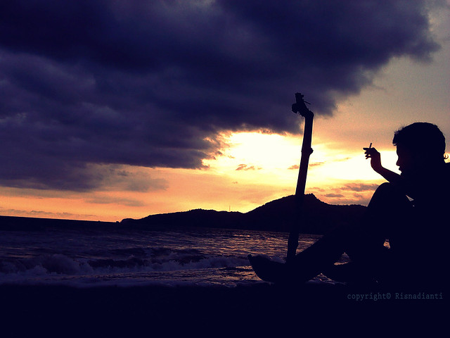 Rizal with sunset Karang hawu Beach