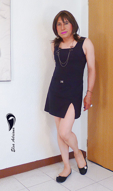 Short black dress, black flats, natural pantyhose.