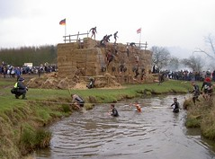 Climbing over the hay bales (The Berlin Wall) and yet more running through water Image