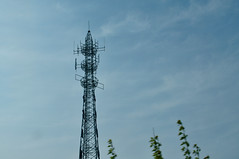 outdoor structure(0.0), electrical supply(0.0), overhead power line(0.0), mast(0.0), transmission tower(0.0), electricity(0.0), cloud(1.0), tower(1.0), spire(1.0), sky(1.0), antenna(1.0),
