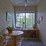 Exposed brick and picture windows make a picture perfect sunroom in Evanston. Also a great spot for painting and taking pictures.