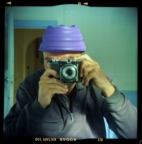 reflected self portrait with Kodak Brownie 20 camera and purple silicone hat by pho-Tony