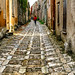 Cobbled street in the medieval town of Erice,Sicily,Italy by dorosario-photos