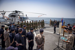 The medal ceremony for the Serbian AVPD was held on the flight-deck of the counter-piracy flagship, HNLMS Tromp