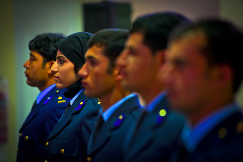 <p>Afghan National Army Air Force 2nd Lt. Niloofar Rhmani, second from left, stands with four other graduates of undergraduate pilot training before they receive their pilot's wings at a ceremony at Shindand Air Base in Afghanistan May 14, 2013. Rhmani was the first woman to successfully complete undergraduate pilot training and earn the status of pilot in more than 30 years. She joined the Kabul Air Wing as a Cessna 208 pilot. (DoD photo by Senior Airman Scott Saldukas, U.S. Air Force/Released)</p>