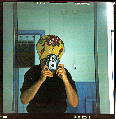 reflected self-portrait with Kodak Brownie Flash 20 camera and floral hat by pho-Tony