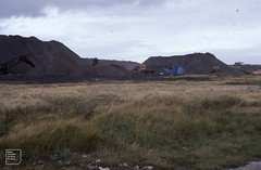 Fly ash tip near power stations taken from sea wall. View Northeast. October 1982, East Aberthaw