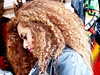 profile of a girl with curls