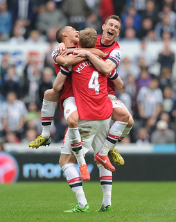 Laurent Koscielny, Kieran Gibbs and Per Mertesacker celebrate after the match