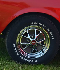 steering wheel(0.0), formula one tyres(0.0), bumper(0.0), automobile(1.0), tire(1.0), automotive tire(1.0), automotive exterior(1.0), wheel(1.0), vehicle(1.0), automotive design(1.0), rim(1.0), alloy wheel(1.0), spoke(1.0),