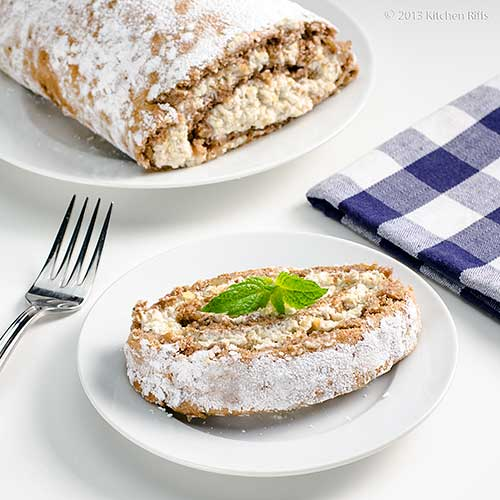 Walnut Roll Cake on plate with mint garnish