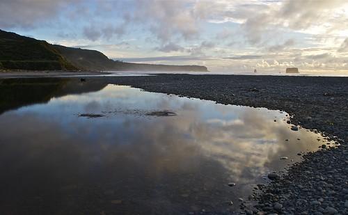 ocean light sunset sea newzealand cloud reflection beach water stone canon landscape coast stream phormium westcoast gravel rivermouth harakeke phormiumtenax rapahoe