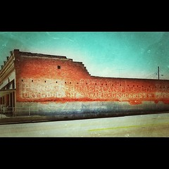 A loooonnng ghost sign covers the side of this old building in Frankston, Texas