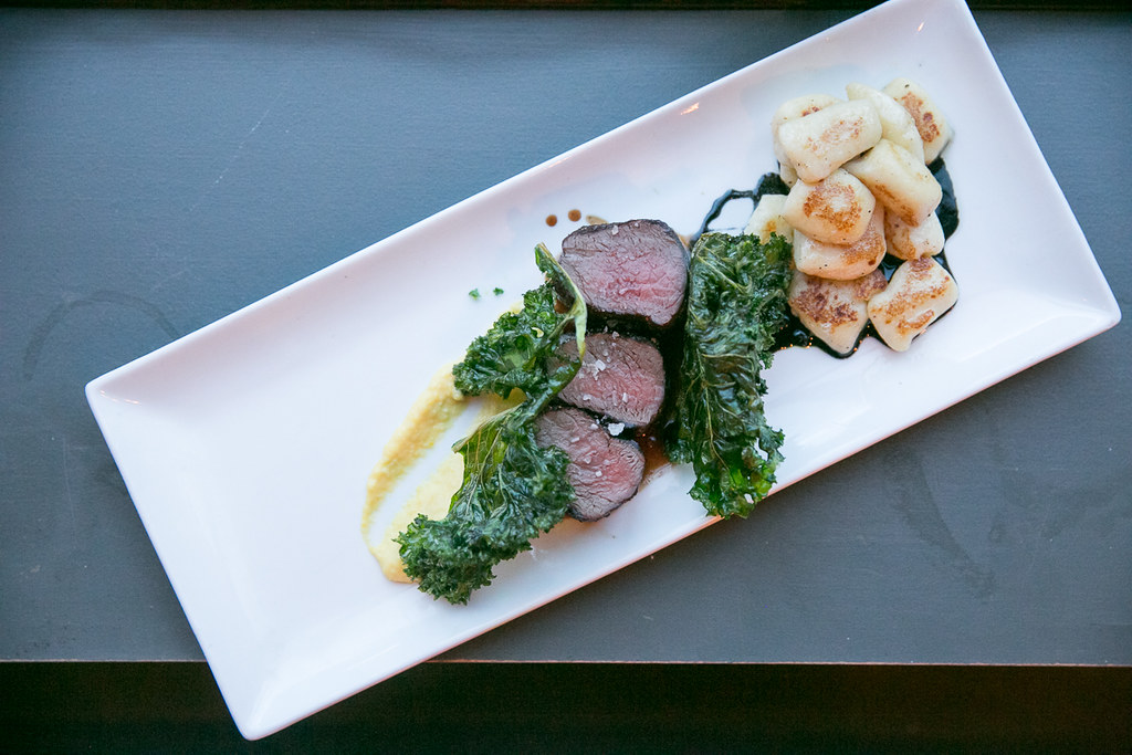 Venison Tenderloin ($32) Seared medium-rare venison loin, potato gnocchi, creamed corn puree, maple and squid glaze, crispy kale chips.