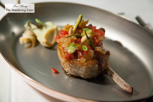 Noir de Bigorre pork chop with sweet bell peppers and artichoke hearts (taken in the kitchen of Le Chantecler)
