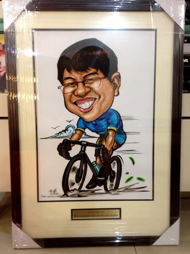 cyclist caricature framed up with metal engraved gold plate