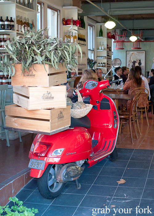 wooden crates and scooter at entrance to pasta emilia surry hills