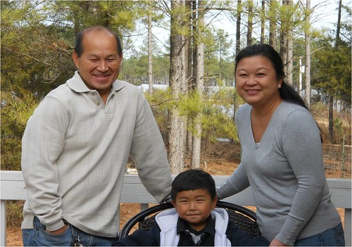Maykia Yang (right), is trying to educate Hmong farmers in North Carolina about Farm Service Agency programs. Pictured with Maykia is her husband Jim (left) and son Marcus.