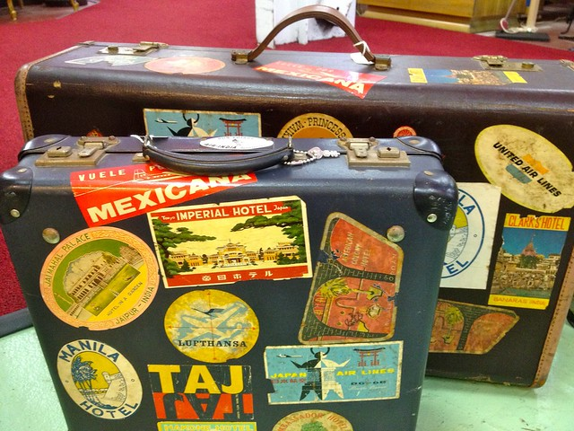 stock Two Leather Suitcases With Stickers