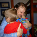 Alex and Zach greet Daddy with Christmas hugs