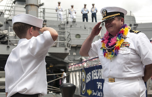 PEARL HARBOR - Lt. Nate Martinez salutes his 11-year-old son as the guided missile frigate USS Reuben James (FFG-57) returns from a seven-month deployment to the western Pacific region.