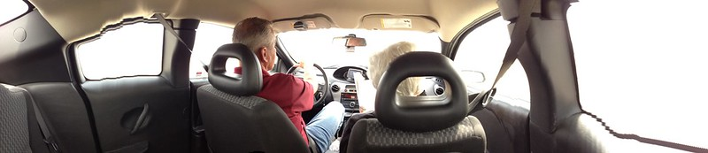 panorama of parentals in the car