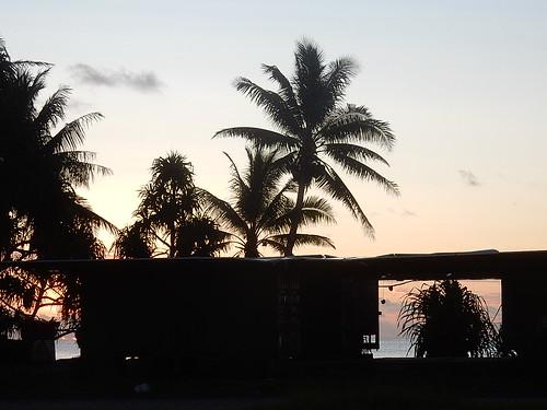 tuvalu funafuti desalinationplant containers palmtrees silhouette sunset