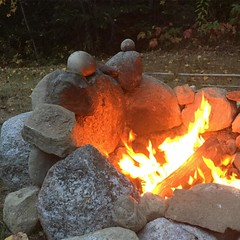 From another angle, it looks like a couple, and larger of the pair is a #heartshapedrock (and could be holding a heart)! #maine #mainelife #firepit at home :heart:️