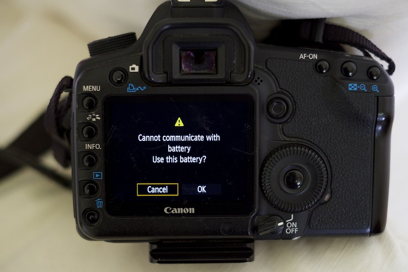 how to pass canon battery warning