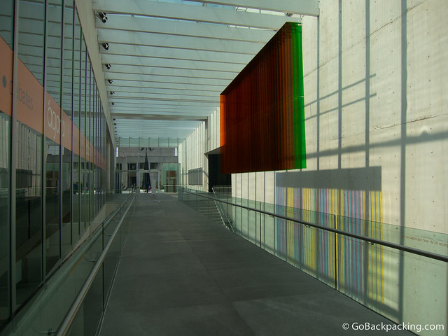 A colorful, hanging sculpture reflects sunlight in the main hall of the Contemporary Art Museum