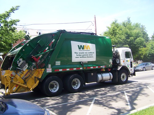 Waste Management trash collection truck with ad