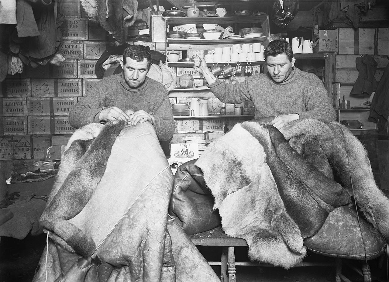 Petty officers Edgar Evans and Tom Crean mending sleeping bags. 16 May 1911